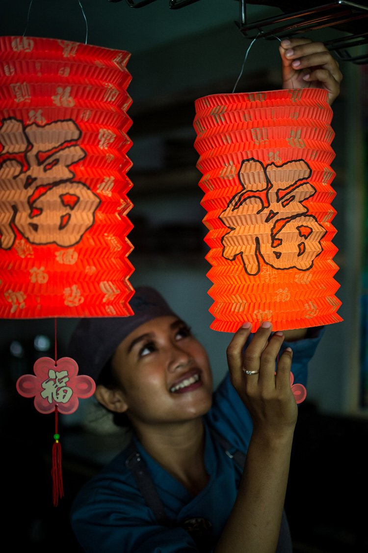 Chinese paper lanterns are hung by the chef at Blue Karma Oasis Escape in Seminyak, Bali
